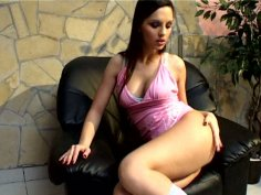 Sexy and amazing brunette Eve shows her long legs and tickles wet pussy