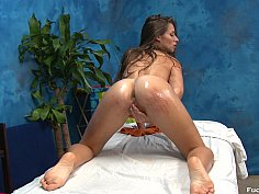 Flexible teen penetrated on massage bed