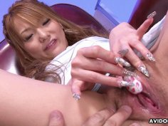 Delightful Japanese fuck doll is playing with a m