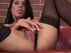 Brunette Lola wears stockings and rubs her wet pussy