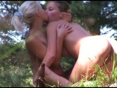 Kinky and voracious lesbians eat each other's wet juicy pussies in fresh air